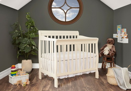 French White Aden 4 in 1 Convertible Mini Crib Side Room Shot