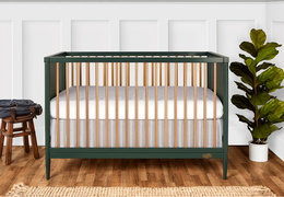 670-OLIVE Clover 4-in-1 Modern Island Crib With Rounded Spindles Room Shot 01